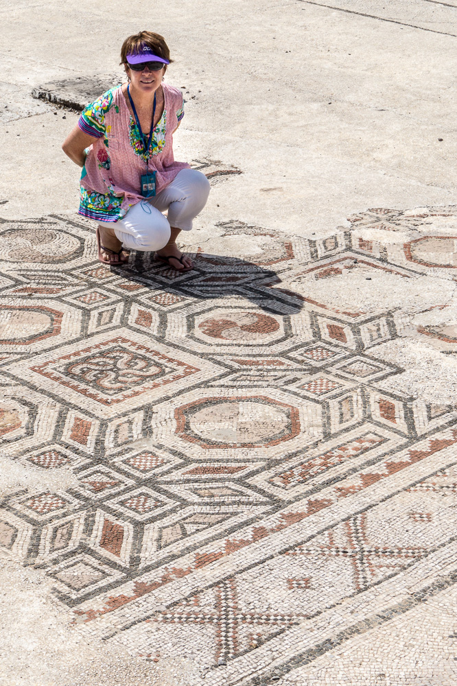 Heather admires 2000 year-old mosaics on the floor of a synagogue in Sardis, Turkey.